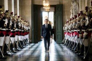 French President Emmanuel Macron walks through the Galerie des Bustes (Busts Gallery) to access the Versailles Palace's hemicycle for a special congress gathering both houses of parliament (National Assembly and Senate) in the palace of Versailles, outside Paris, on July 3, 2017. / AFP PHOTO / POOL / Etienne LAURENT